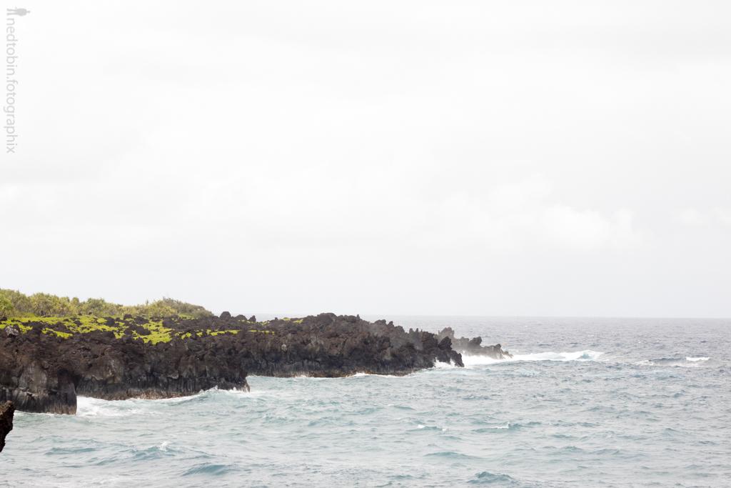 the ocean at black sand beach on the hana highway in maui, hawaii