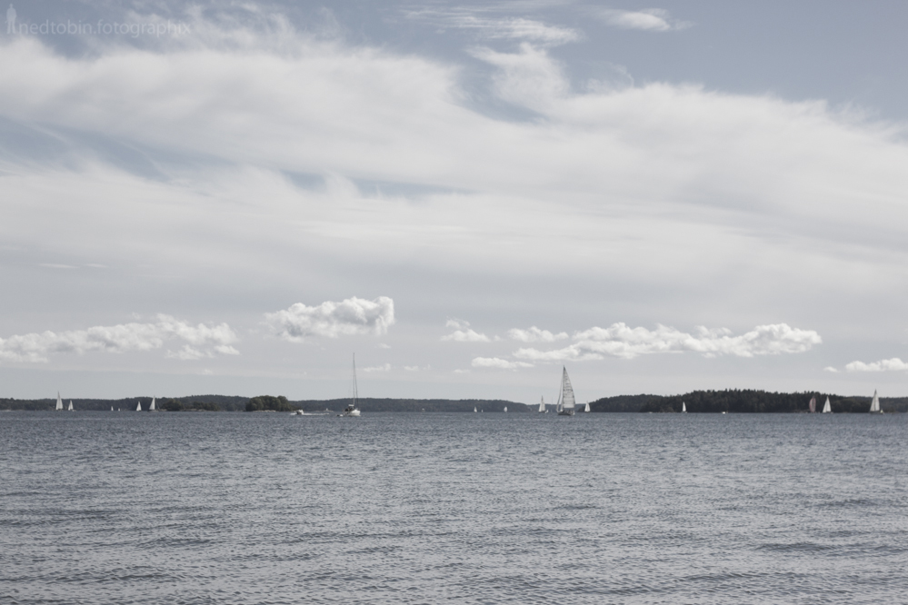 View of clouds forming over the east coast of sweden in the sea with sailboats